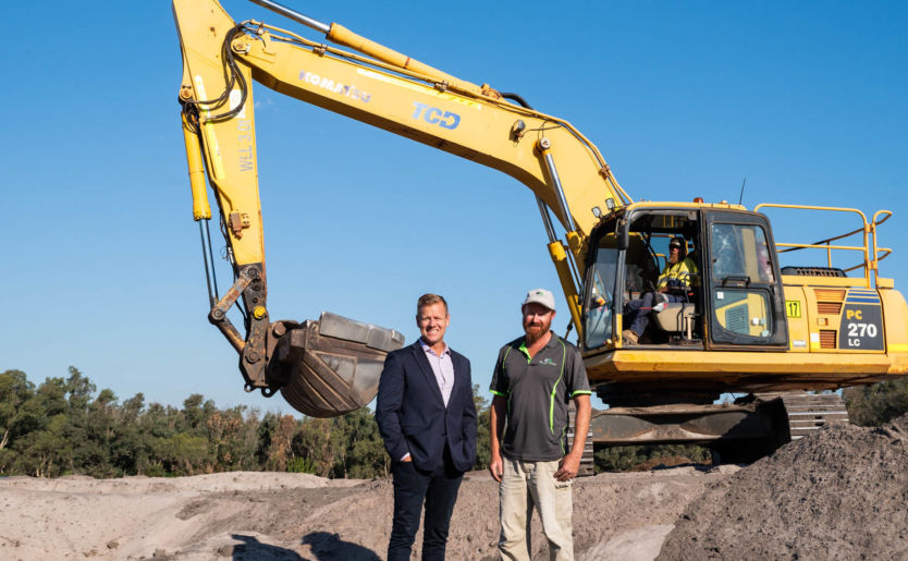 Johnno Wroth, Director of Monument parent company M/Group, stands with construction workers as stage one construction works are underway at The Wedge land development located in Wellard North