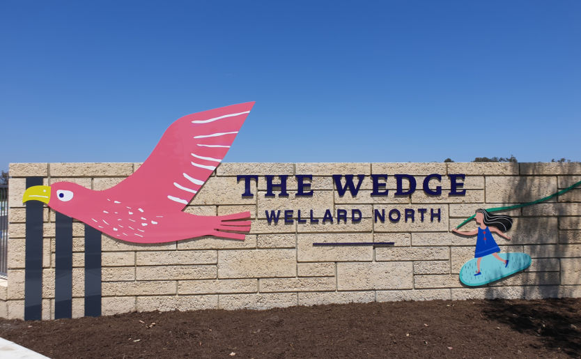 Front entrance wall of The Wedge in Wellard North with the branding mascot eagle and little girl decal
